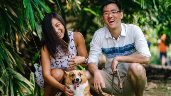 a happy couple with their dog