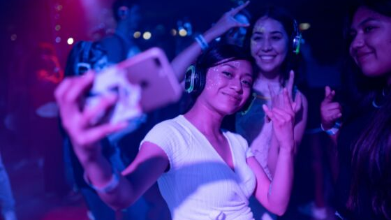 a girl taking a selfie in the party
