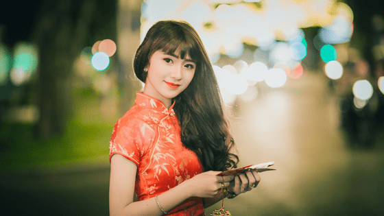 a chinese woman in a traditional dress